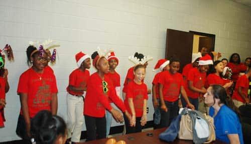 East Side students entertain School Board members