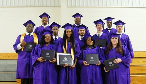 Thirteen graduate from REACH Academy