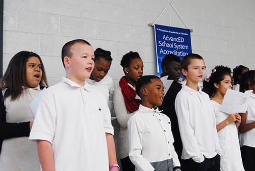 Choir sings for School Board members