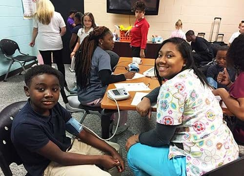 Health students help with health screenings