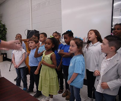 April School Board meeting features Anderson choir